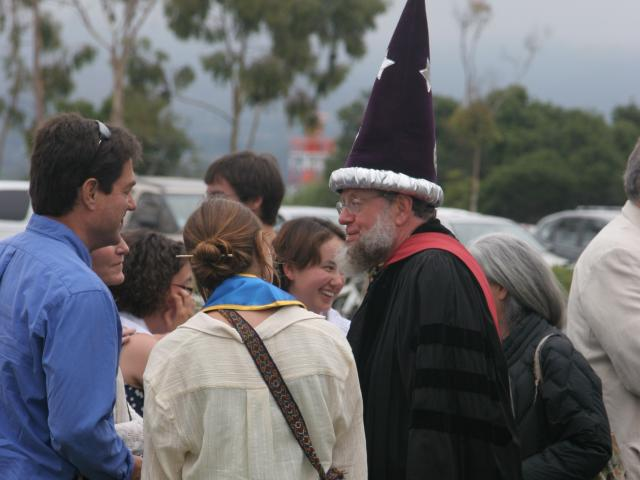 Professor Tiffney talking with students after Commencement in 2013